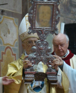 Archbishop Edmond Y. Farhat giving blessing with Holy Face.