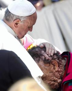Pope Francis embracing the sick