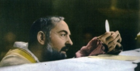 St. Padre Pio gazes at the Eucharistic Face of Christ