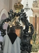 Rector of the Shrine Padre Carmine Cucinelli places the Holy Veil in the movable reliquary