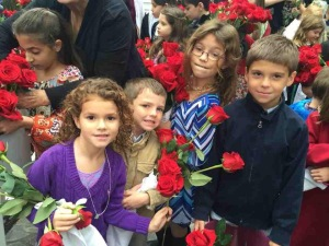 Children getting ready for procession with their roses photo: Patricia Enk