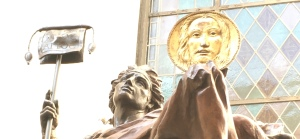 Detail of St. Michael sculpture holding the Holy Face by Cody Swanson